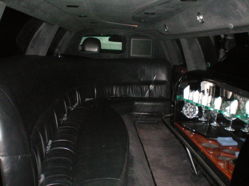 Front seats in back of limo with bar